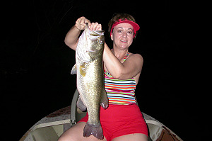 Steve Drexler's wife with a big bass caught at night
