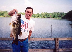 Randal Cowart with 14 lb 1 oz bass caught from Lake Ely, 2000