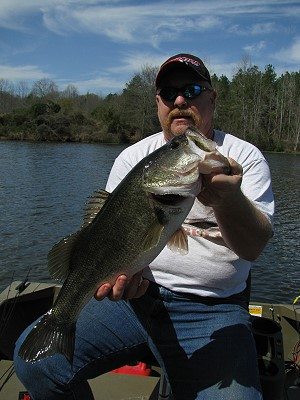 John Nolan with big bass, July 08