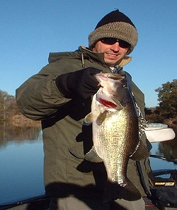 Donnie Burchfield with 6 1/2 bass from Bar-D, Dec. 03