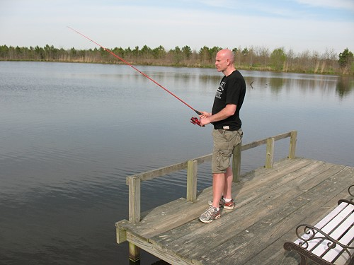 Dave fishing from a lake pier