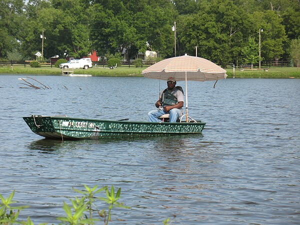 John Heard, Marion, keeps cool while bass fishing in July.