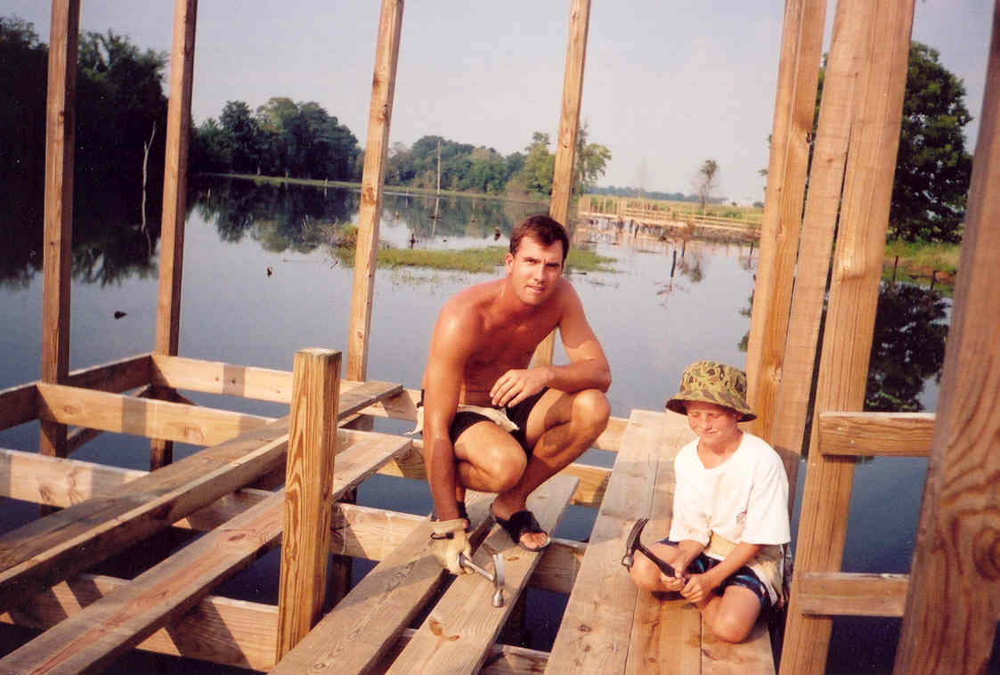 Chad and Hudson Wilson working on a pier on Snag Lake