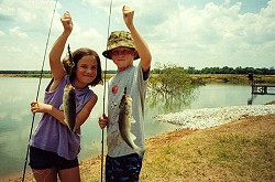 Hudson and Lauren Wilson with two nice bass from Sturdivant Lake (summer, 2002).