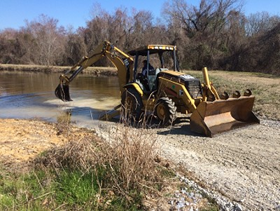 Allen Rayfield on trackhoe... swamp lake ramp